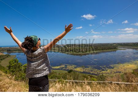 Woman enjoying her freedom with open arms, Australia