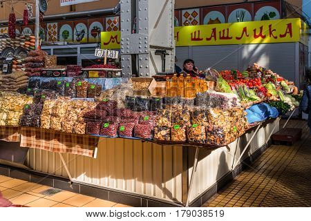 Kyiv Ukraine - March 29 2017: Display with dry fruits seeds sunflower oil and vegetables at Besarabsky market one of the iconic markets of Kyiv Ukraine.
