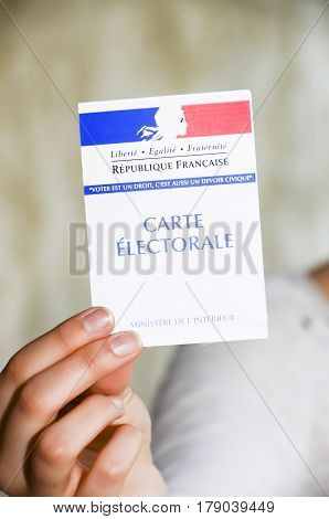Marseille France - March 19 2017: woman holding a french election card to vote in the presidential elections