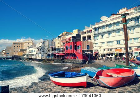 Beautiful View Of El Medano, Little Town In The South Of Tenerife. Red Wooden Fishing Boats On The B