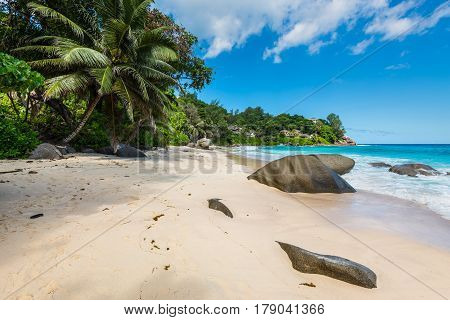 Spectacular Carana Beach with large granite boulders on the Northern end of Mahe Island Seychelles