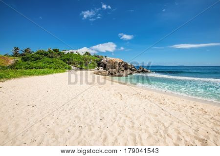 Sunny day on Anse Nord D'Est beach in the north of Mahe Island Seychelles