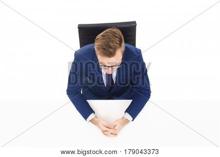 Overhead view of a handsome businessman in office. Business and office concept.