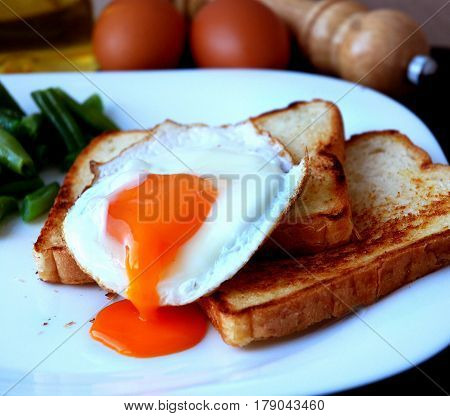Food, egg dishes, suggest scrambled eggs and toast.