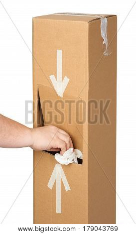 Man's hand throwing trash out into self made trash box. Isolated on white.