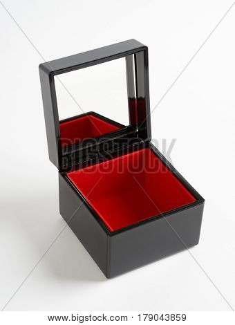 Black plastic glossy gift box with mirrow and red bottom isolated on white