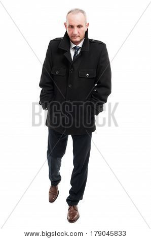 Full Body Of Middle Age Business Man Walking Wearing Overcoat