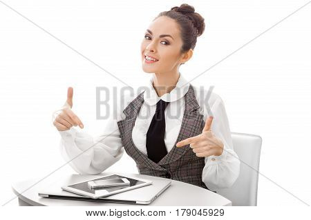 Business woman pointing on smartphone, laptop, tablet pc. Conceptual photo of online store, service center, sync, guide to buy new devices or to sell old gadgets. Happy smiling female isolated on white background.