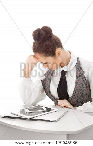 Business woman looking on smartphone, laptop, tablet pc. Attractive girl hard thinking isolated on white background. Conceptual photo of online store, service center, sync, guide to buy new devices or to sell old gadgets
