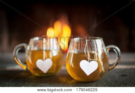 Tea for two by the fireplace