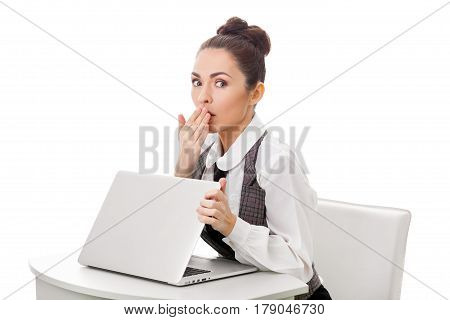 Image of young employer looking at laptop with surprise in office. Business and office concept surprised businesswoman using her laptop computer. Woman looking at camera against isolated white background