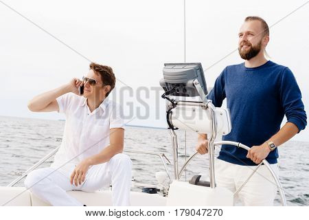 Happy friends traveling on a yacht. Tourism, vacation, holiday, concept.