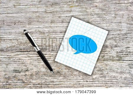 Blue Cloud Symbol On Checkered Paper Note With Pen. Wooden Background
