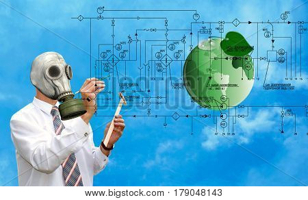 An environmental engineer in a gas mask designs technologies for cleaning the environment from polluting industrial emissions