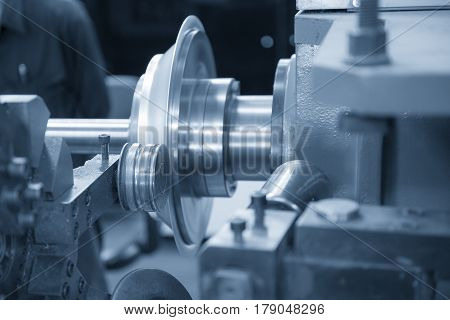 The CNC spinning machine forming the part with light blue scene.Bending flang process in CNC spining machine
