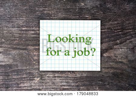 Looking For A Job Text On A Checkered Note. Wooden Background