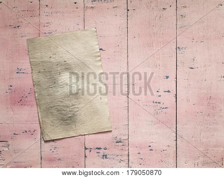 old paper on grunge pink wooden background