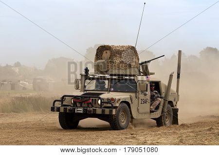WESTERNHANGER, UK - JULY 21: A Hummer recon vehicle drives around the show arena for the public to view at the War & Peace Revival show on July 21, 2016 in Westernhanger