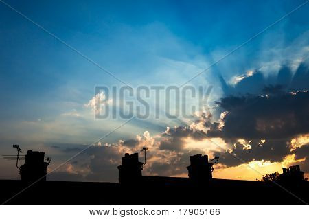 Sunbeams Over Chimney Silhouette