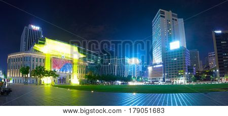 SEOUL SOUTH KOREA - MARCH 28 2017: City hall building with recreational plaza and business buildings near it - Seoul South Korea - March 28 2017