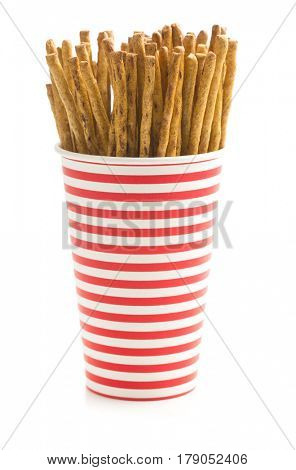 Salty pretzel sticks in paper cup isolated on white background.