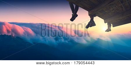 Hikers Sit On A Wooden Flooring