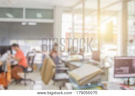 Businessmen blur in the workplace.Table Top And Blur Office .abstract blur background work in lab with computer. shallow depth of focus service room color people teamwork winner screen feat place desk