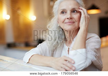 Grey-haired pensioner thinking of something pleasant at leisure