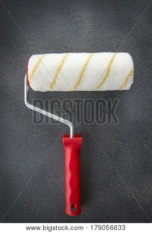 Building paint roller on dark gray background
