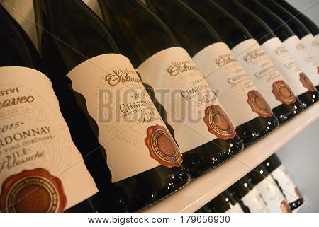 PRAGUE, CZECH REPUBLIC - MARCH 20, 2017: Chardonnay wine bottles in fridge in prague restaurant