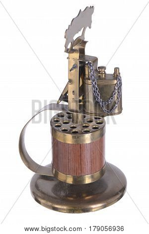 Retro lighter gasoline on a stand with a keg for cigarettes and a handle vintage old thing lid wick fire flint isolated