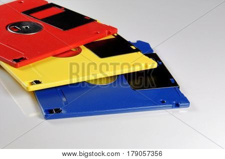 Old color floppy disk. Red yellow and blue.