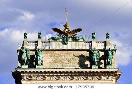 golden eagle and sculptures in dominating posture atop hofburg, austria, vienna poster