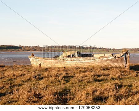 Boat In The Mud With The Tide Out
