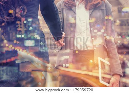 Double Exposure Businesswoman shaking hand for business successfulBusiness Concept