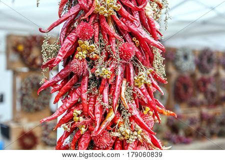 Floral decorative ornament with red cayenne pepper.