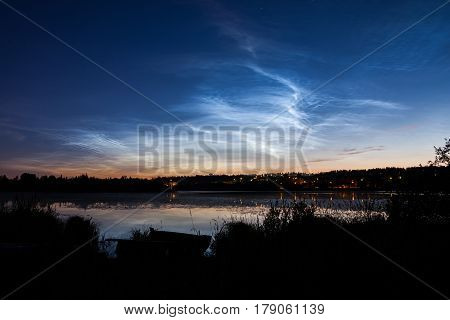 Noctilucent clouds at night sky in Finland