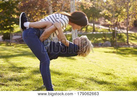 Loving Mother Hugging Son In Park