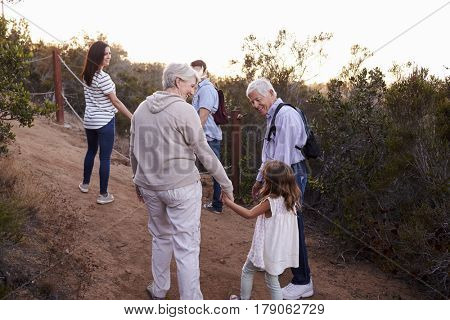 Multi Generation Family On Hike Through Countryside