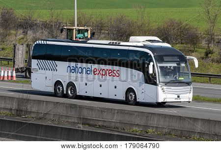 Watford UK - March 13 2017: British National Express bus in motion on the M1 motorway