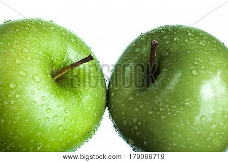 Extreme close-up image of two green apples