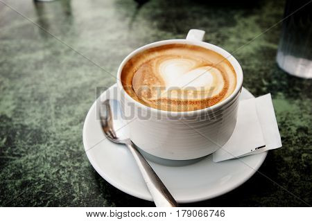 Coffee cup of cappuccino with art, heart shape