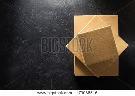 cardboard box on black background surface