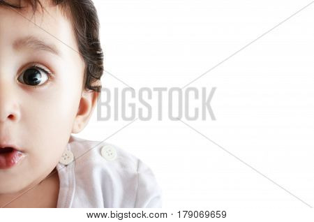 Surprised adorable child close-up portrait isolated on white background