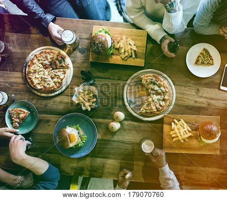 Group of people celebrate party with food and beer