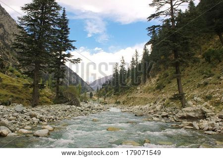 Beautiful Landscape in the mountains with blue skys pure green water and trees in swat valley kpk Pakistan