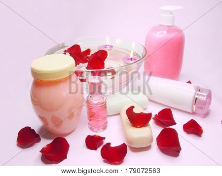 spa hair mask creme liquid soap candles essenses and red rose petals