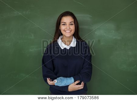 Young Student in Uniform with Chalk Board Background Portrait