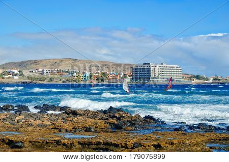 Playa El Medano, Summer Landscape. Windsurfers On Tenerife Ocean Beach.