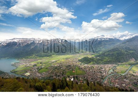 Aerial view of city district and Interlaken from viewpoint at Harder Kulm in Interlaken Bern Switzerland.